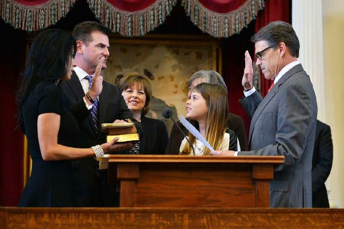Brandon Creighton, R-Conroe, is sworn into the Senate District 4 seat by Governor Rick Perry at the House chambers in Austin on Tuesday. Creighton takes over the position in January for former Senator Tommy Williams.