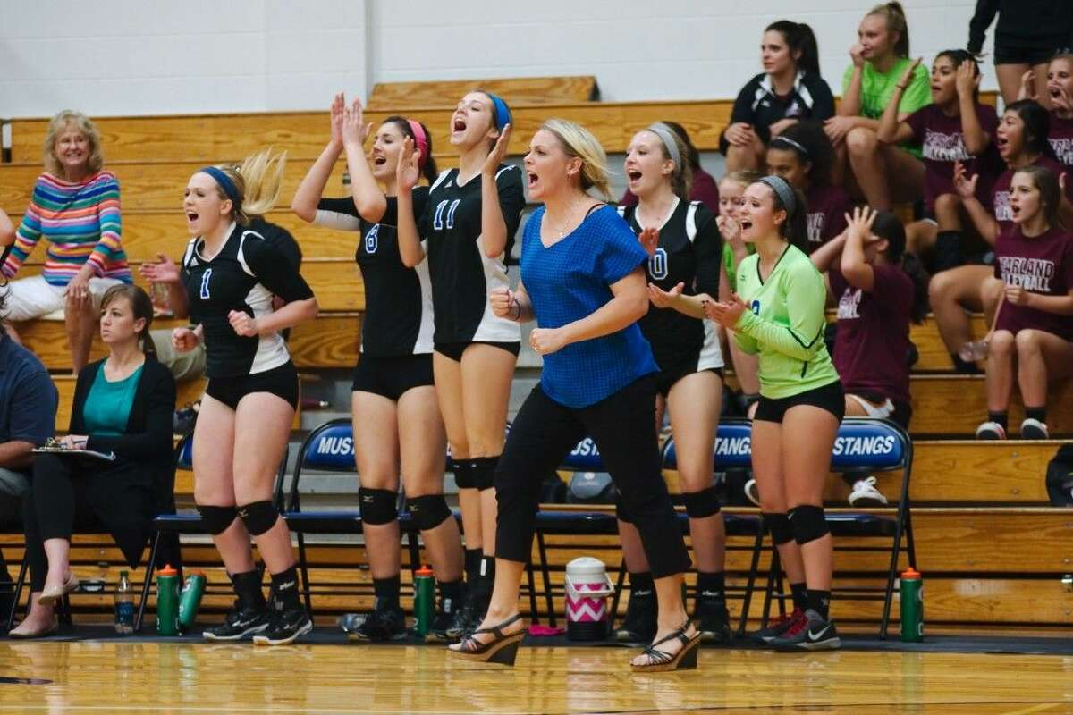Friendswood volleyball coach Kylie Kerlin and the Mustangs celebrate a point against Pearland Tuesday.