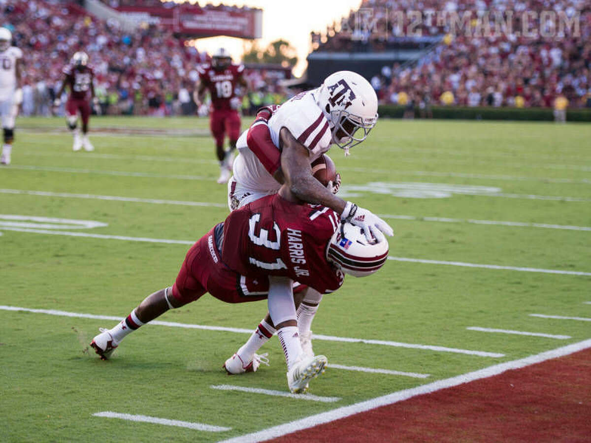 Kenny Hill threw for 511 yards and three touchdowns, and the Aggies rolled to a 52-28 season-opening win over South Carolina on Thursday night. Texas A&M finished with 656 yards of offense on the night.
