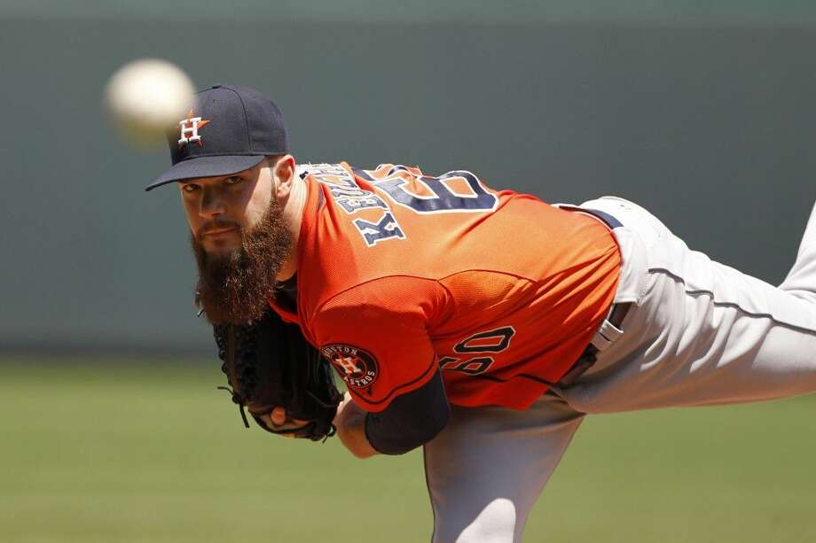 Houston Astros pitcher Dallas Keuchel warms up in the first inning of a against the Kansas City Royals last week. Keuchel has become a recognizable star as the Astros ace along with his beard.