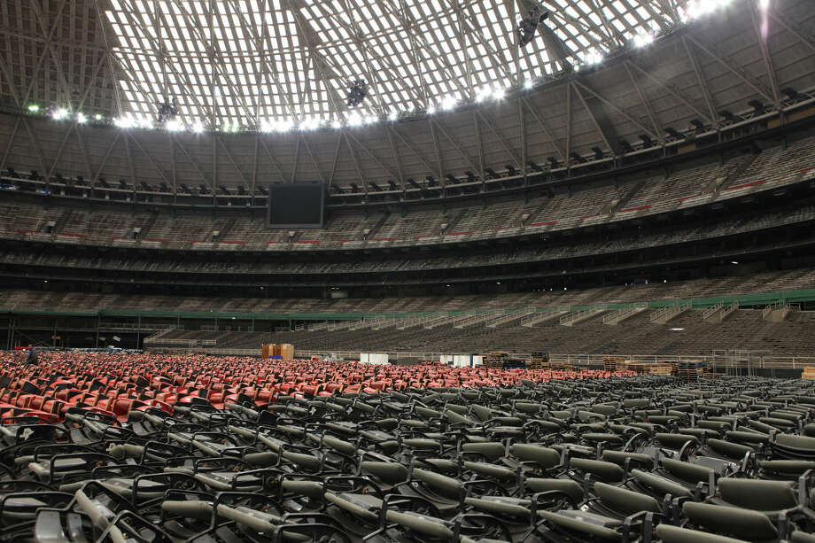 Hundreds of upper deck seats stacked on the floor of the Astrodome in Houston, Texas on Friday, Feb. 13, 2015. Photo: Staff Photo By Alan Warren
