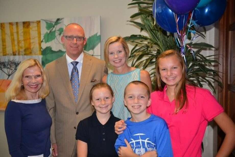 Jeff Shipley has been named a 2014 Hometown Hero. In the back row from left to right are Dr. Ann Snyder, President and CEO at Interfaith of The Woodlands, Jeff Shipley, and his wife Susie. In the front row from left to right are his children Caroline, Matthew and Katie Shipley.
