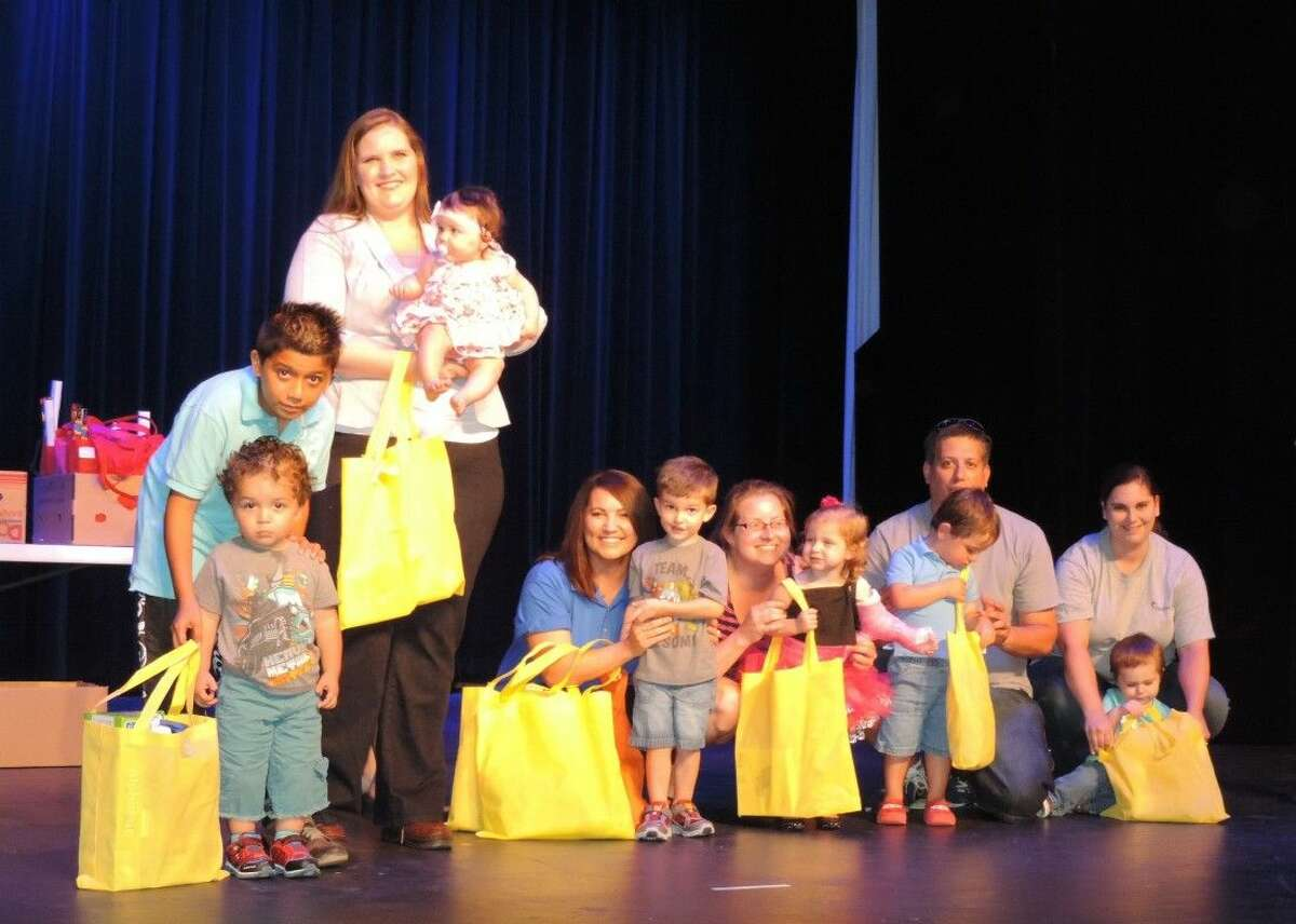 Liberty Municipal Library wrapped up its summer reading program with awards given to the top readers. The prize winners for the birth through 2 years old group are (left to right) Angel Lujon with big brother Isaac Lujon, Jessica Contreras with daughter Isabella, Children's Librarian Melissa Moss, Jackson Kline, Shaunna St. Clair and daughter Bella, Michael McNeil and son Logan, and Brittany Pritchett and son Wyatt.