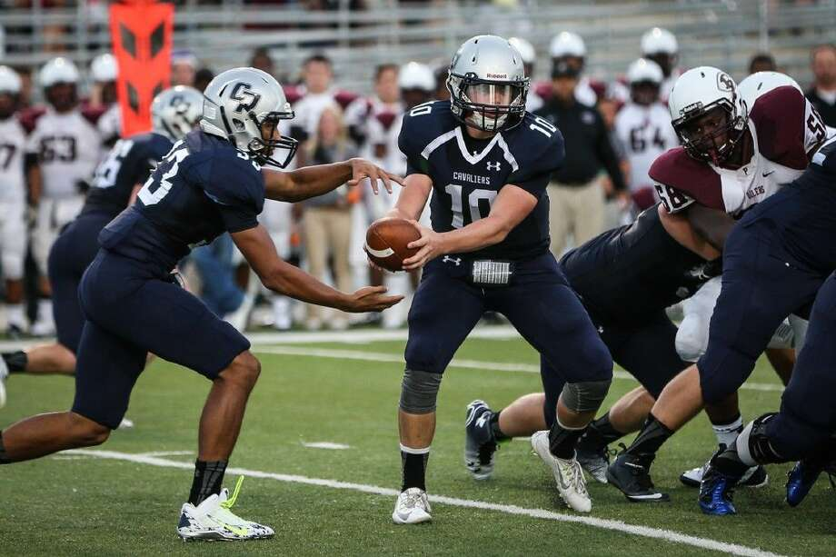 College Park's Robert Ferguson (10) hands the ball off to Dominic Garcia in the Cavaliers' 25-14 loss to Pearland at Woodforest Bank Stadium.