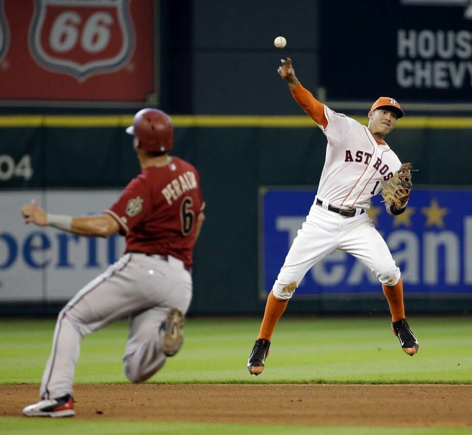 Astros shortstop Carlos Correa makes the play to retire the Diamondbacks' Welington Castillo.