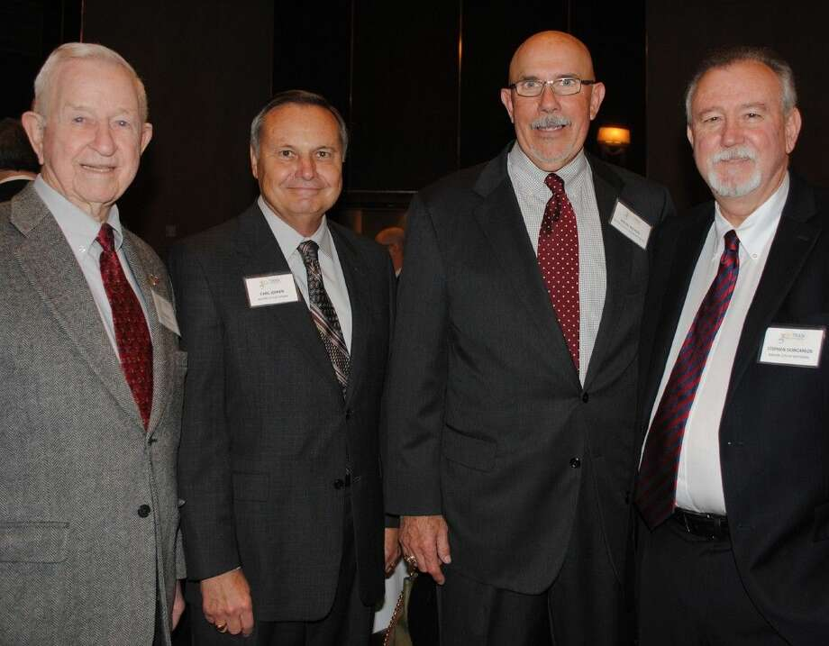 Mayors Tom Reid of Pearland, Carl Joiner of Kemah, Michel Bechtel of Morgan's Point and Stephen DonCarlos of Baytown were among eight mayors attending BayTran's State of the Port Luncheon featuring Port Executive Director Roger Guenther.