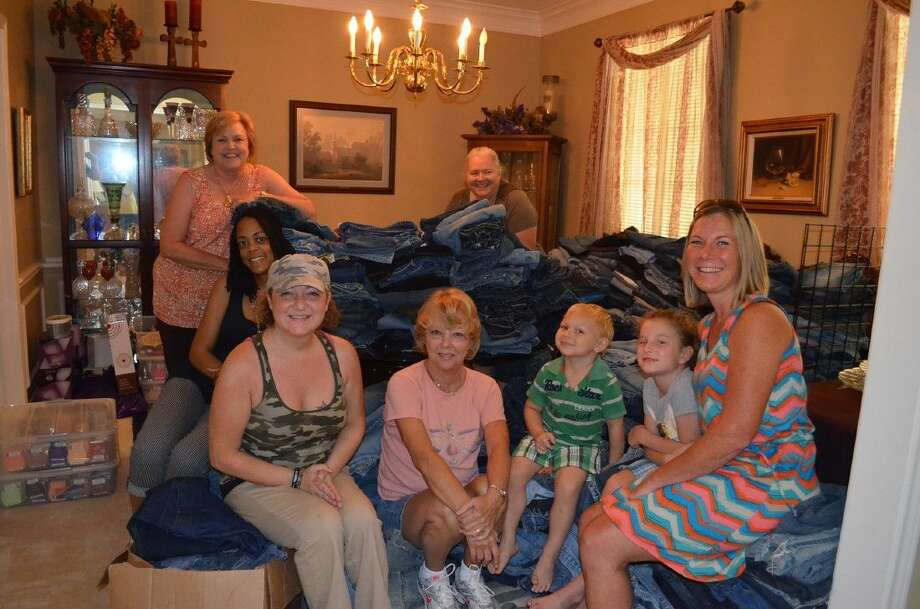 Women on a Mission to Earn a Commission of Magnolia recently donated 1,181 pairs of jeans to Montgomery County Emergency Assistance to help qualified students prepare for Back to School. Photo: Submitted