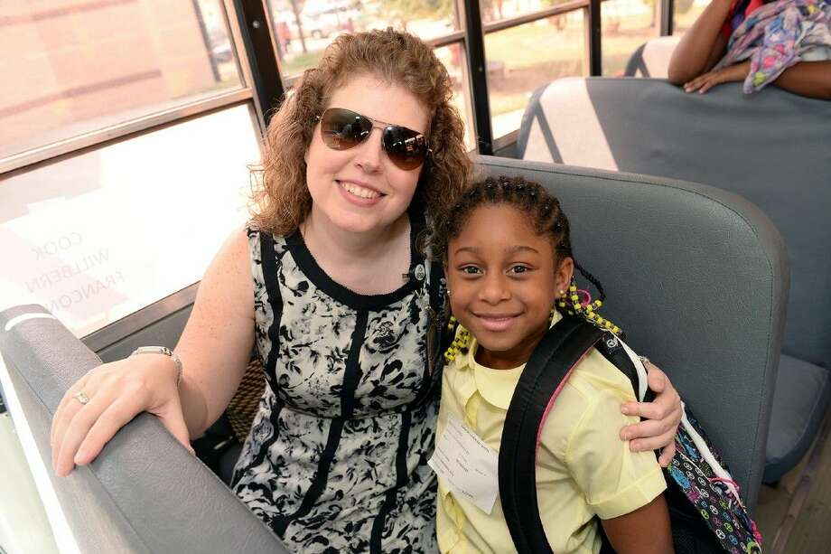 Dr. Ashley Clayburn, assistant superintendent of school improvement and accountability, served as a Bus Buddy at Francone Elementary School with students like fourth-grade student Haley Clurksy.