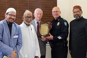 Imam Daniel Hernandez, Brother Youssef, Mayor Reid, Assistant Chief Johnny Spires and Dr. Abul Azad.