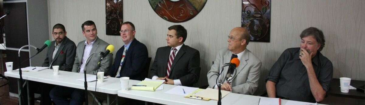 This undated file photo shows participants on a panel representing three factions of the Republican Party. From left to right: Liberty Conservatives Art Sisneros and Keith Strahan, Traditional Republicans Klint Bush and Briscoe Cain and Tea Party members Aubrey Vaughn and Dale Huls.