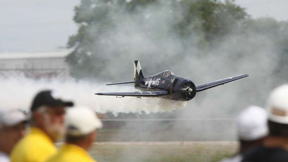 Bucky Keller's Navy Hell Cat flies with smoke during the Fort Bend Radio Control Club's 16th annual Model Air Show and Model Aircraft Fly-in at the club's flying field in Rosenberg on Saturday, Aug. 30. The Model Air Show is held to raise money to benefit the Muscular Dystrophy Fund.