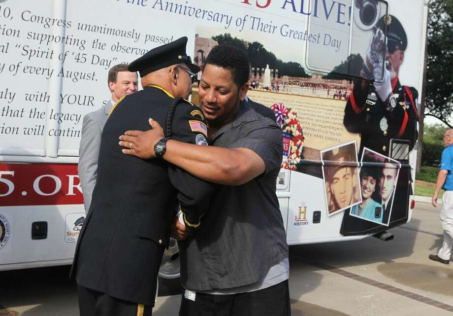 U.S. Army Veteran Greg Lewis hugs Auston O'Neill of the Spirit of '45 Express as it visits Service Corporation International in Houston, Texas during a national tour to raise awareness for the upcoming 70th anniversary of the end of World War II. Photo: Alan Warren
