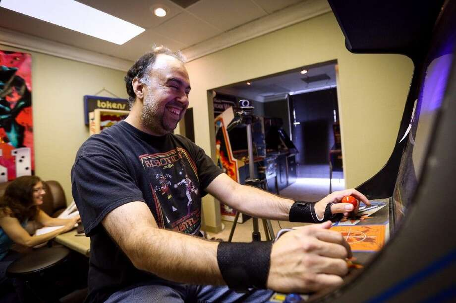 David Gomez, a vintage arcade games enthusiast, enters the 24th hour of a marathon playing Robotron: 2084 on a single coin Sunday, Aug. 29, 2014, at The Game Preserve. Photo: Michael Minasi