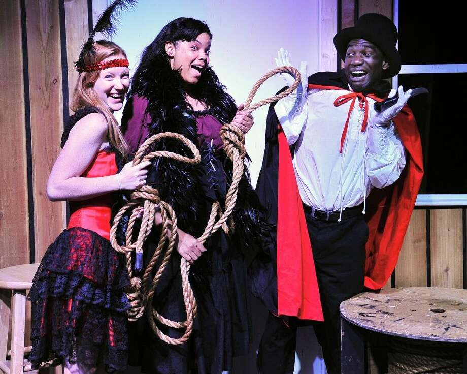 """From left, San Jacinto College students Tawny Williams of Dickinson (as the Cardgirl), Renee van Niftrik of Pearland (as Ida Rhinegold), and Jaylon Scott of Deer Park (as the Villian) are cast members of """"Dirty Works at the Crossroads,"""" a melodrama which will open on Sept. 3. Photo credit: Rob Vanya, San Jacinto College marketing, public relations, and government affairs department."""