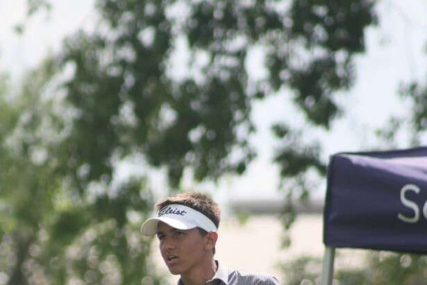 Dawson's Alec Brown watches the flight of his ball Thursday at the Region III-6A golf tournament. Brown, a sophomore, shot a 69-71-140 to earn a state berth.