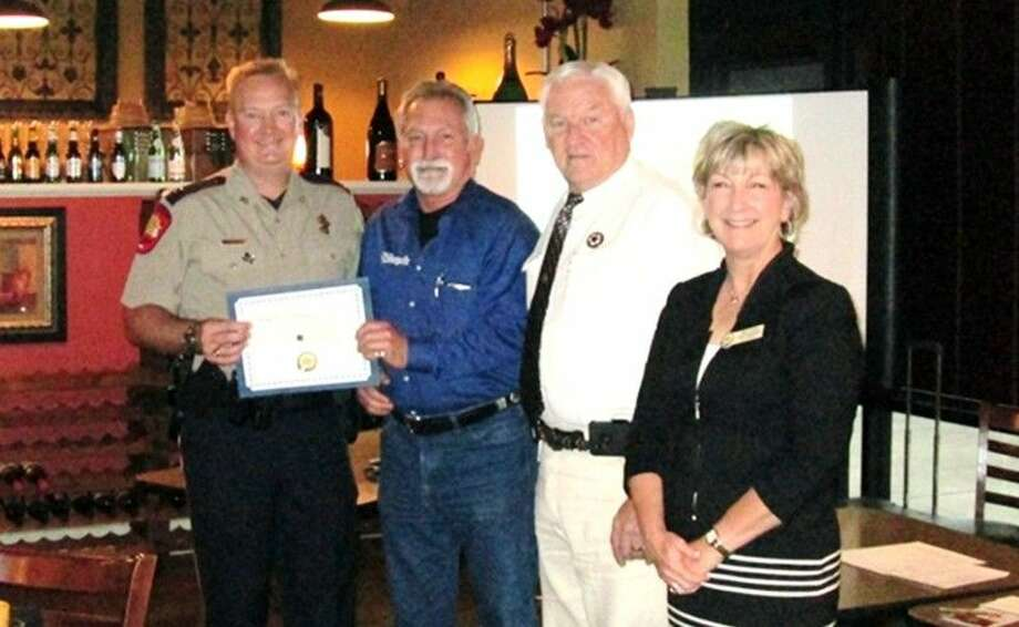 Magnolia Parkway Chamber of Commerce held its monthly networking breakfast at Eden Café in Magnolia on Tuesday, April 12. During the breakfast, Captain Rand Henderson was recognized as the Public Servant of the Quarter. The certificate was presented by John Chadwick of Triple J Firearms, the 2016 Sponsor for this award. Sheriff Tommy Gage provided the introductions and stated that he was pleased with the selection for his replacement and believes the County will be well served. Captain Henderson completed the Basic Academy (TPOALA) and began his law enforcement career with Montgomery County Sheriff's Office in 1994. He also attended Sam Houston State University, where he earned his Bachelor of Science and Master of Science degrees in Criminal Justice. In addition, he is a graduate of the FBI National Academy in Quantico and a graduate of the Law Enforcement Management Institute of Texas. Throughout the years, he moved up the ranks and was eventually promoted to captain in 2009. Captain Henderson was nominated as our new Montgomery County Sheriff and will be sworn into office on Jan. 1, 2016. Chamber members and guests are invited to attend the event, where they can enjoy breakfast and network with fellow members. Photo: Submitted