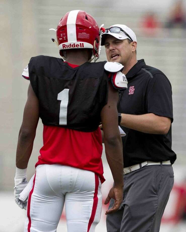Houston head coach Tom Herman talks with quarterback Greg Ward Jr. during the spring football game at TDECU Stadium Saturday. Ward completed 18 of his 28 passes for 303 yards and three touchdowns. Photo: Jason Fochtman