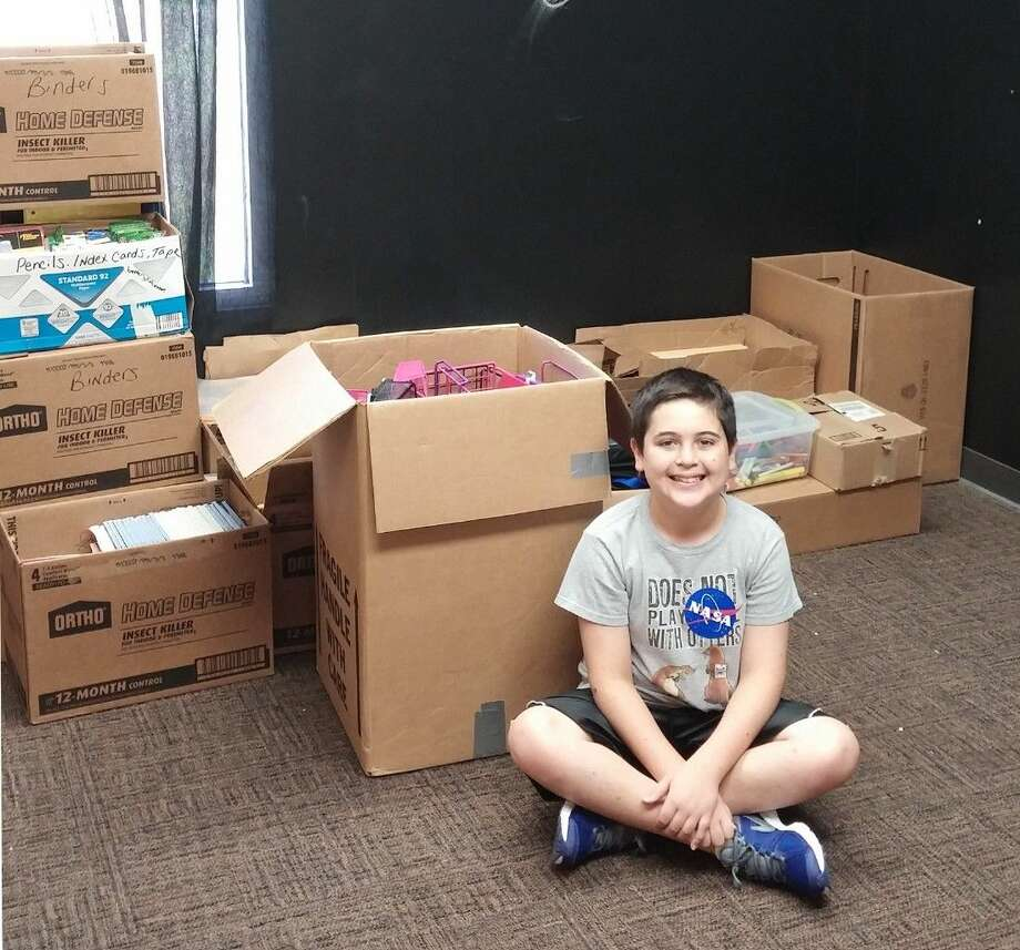 "Submitted PhotoHamilton seventh-grade student Max Diehl organized his service project, titled ""Privileging the Underprivileged,"" encouraging classmates to donate gently used school supplies for the less fortunate. Photo: Submitted Photo"
