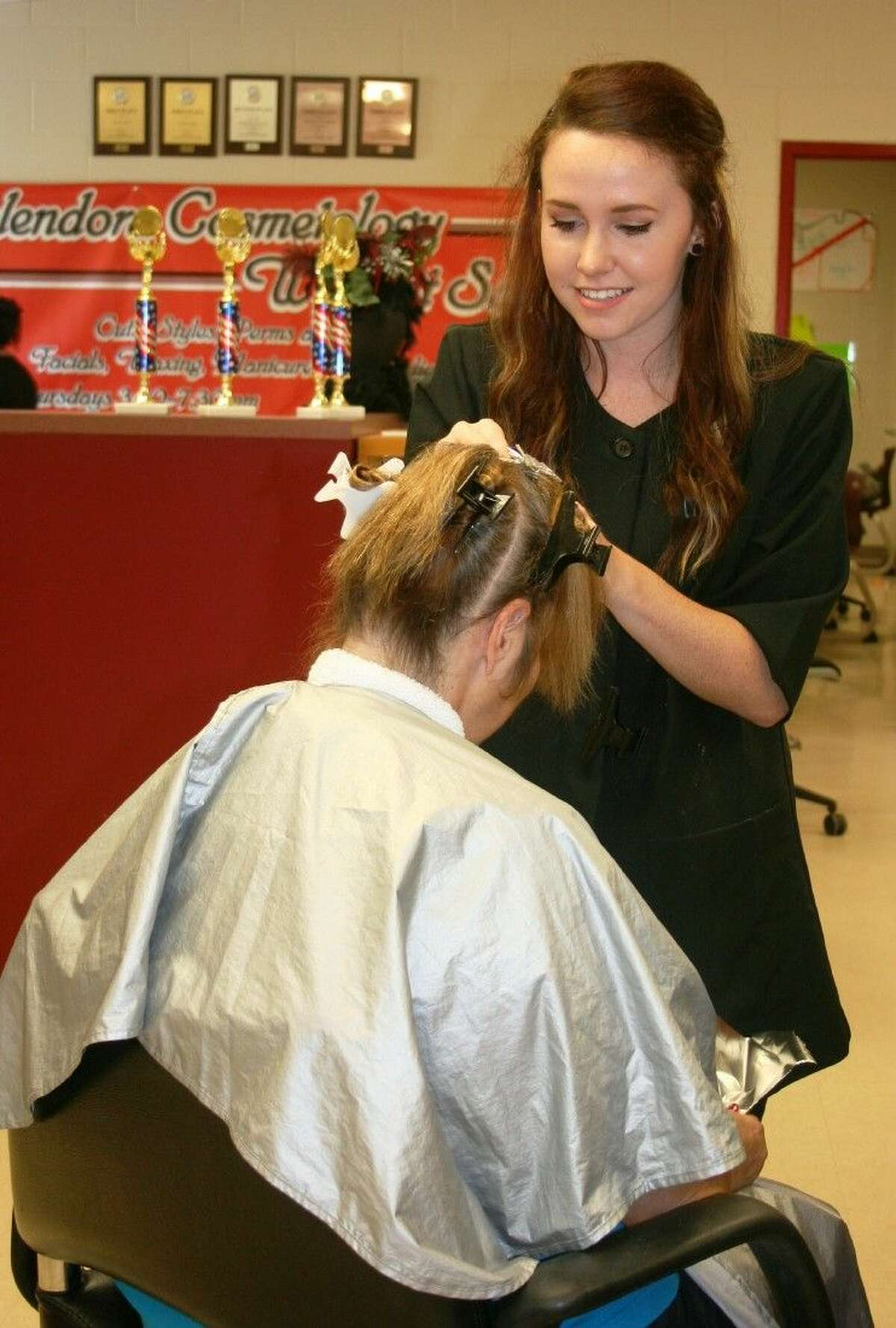 SISD student Callie Daniels, a member of the Splendora ISD cosmetology program, is among the students participating in the programs Salon Night, which is open to the public on Thursdays.
