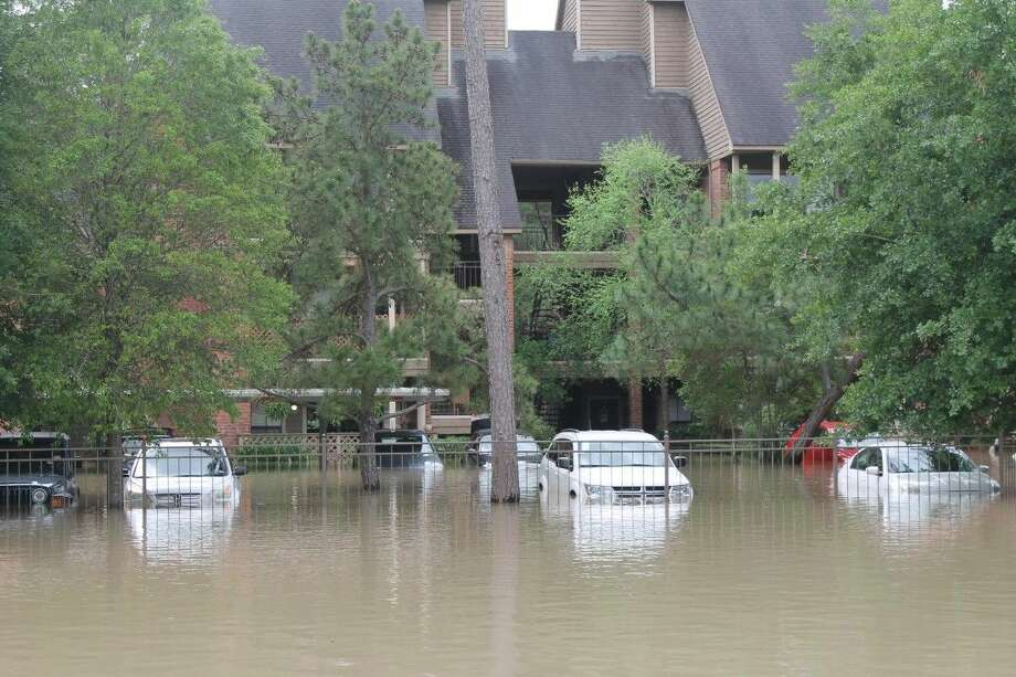 The Chasewood Apartments at Cypresswood Dr.and Cutten Rd. is fully covered due to Cypress Creek overflowing its banks. Photo: Taelor Smith