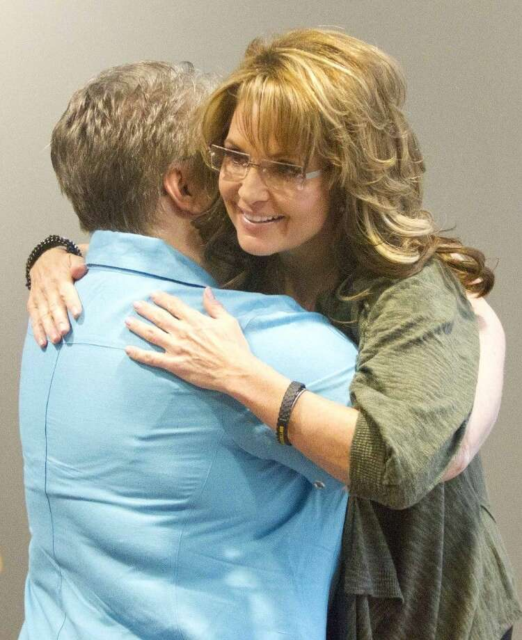 Staff photo by Jason FochtmanLinda Armstrong gets a hug from Sarah Palin before speaking at a gala fundraiser event benefiting Mighty Oaks Warrior Foundation at WoodsEdge Community Church Friday. Photo: Jason Fochtman