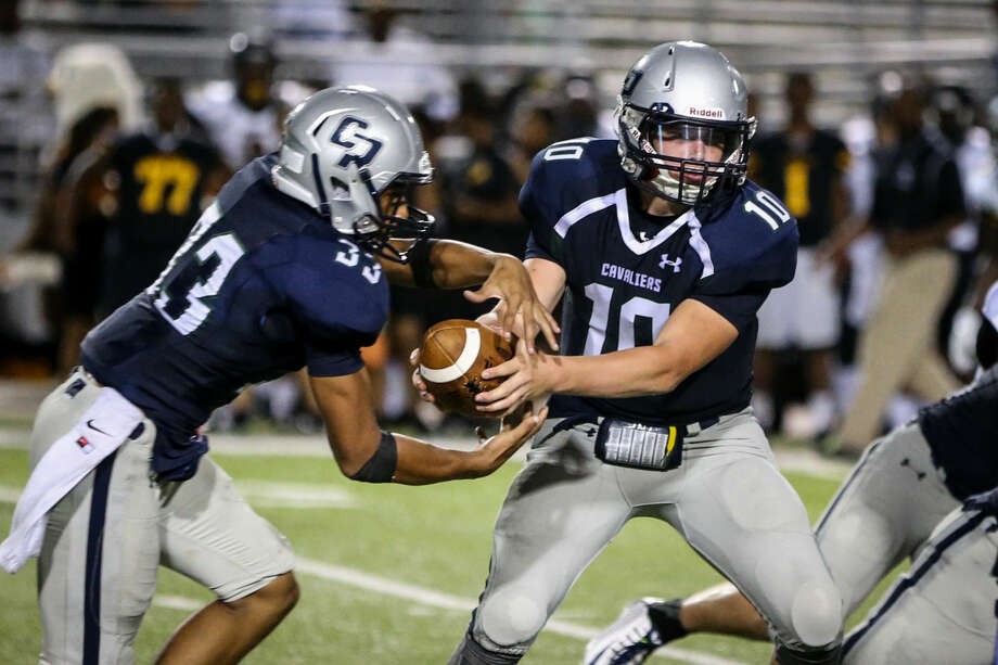 College Park's Robert Ferguson (10) fakes a hand off to Dominic Garcia (33) during the high school football game against Eisenhower on Friday, Sept. 5, 2014 at Woodforest Bank Stadium. Photo: Michael Minasi