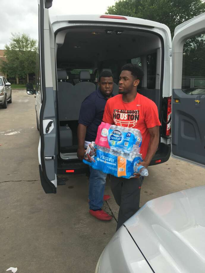 University of Houston football players donated and delivered bottled water near the Campbell Center in the Spring area April 19 in an effort to assist neighborhoods affected by recent flooding. Photo: UH Athletics Media Relations