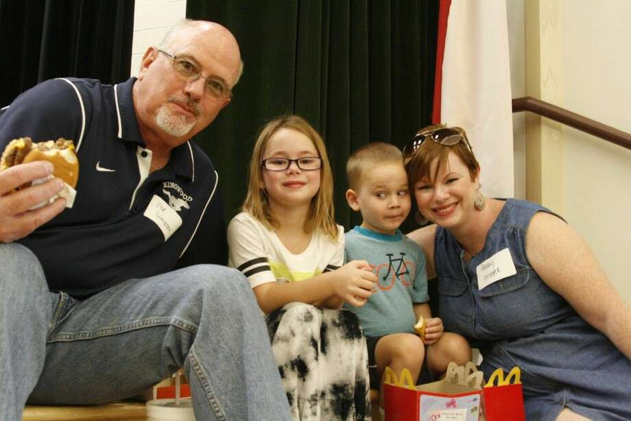 Zoe Simpson with grandchildren, Zoe and Charlie Knippers and Ashley Knippers during the K.I.S.S. luncheon at Eagle Springs Elementary on Friday, Sept. 5, 2014.