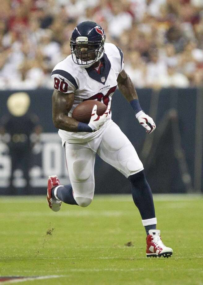 Staff photo by Jason FochtmanHouston Texans wide receiver Andre Johnson (80) runs after making a catch during the second half of an NFL football game Sunday, Sept. 7, 2014, in Houston. Photo: Jason Fochtman