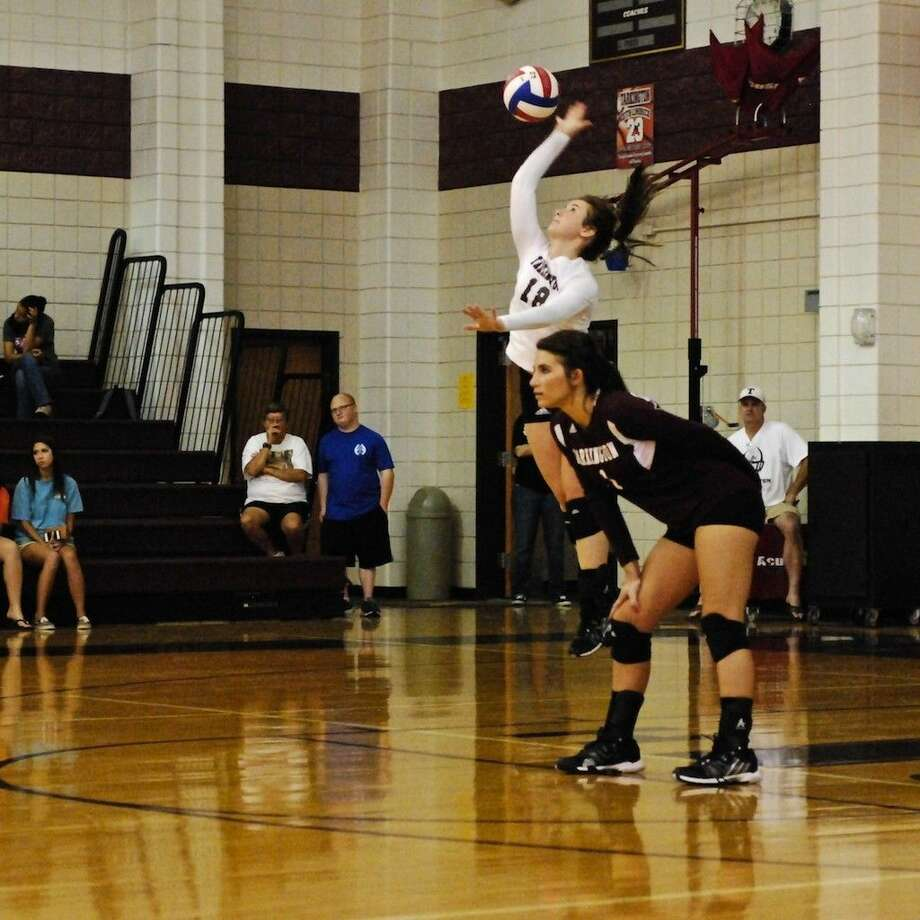 Hattie Lang aced two serves in a row during the third set against Nederland Friday, Sept. 5. Photo: Casey Stinnett