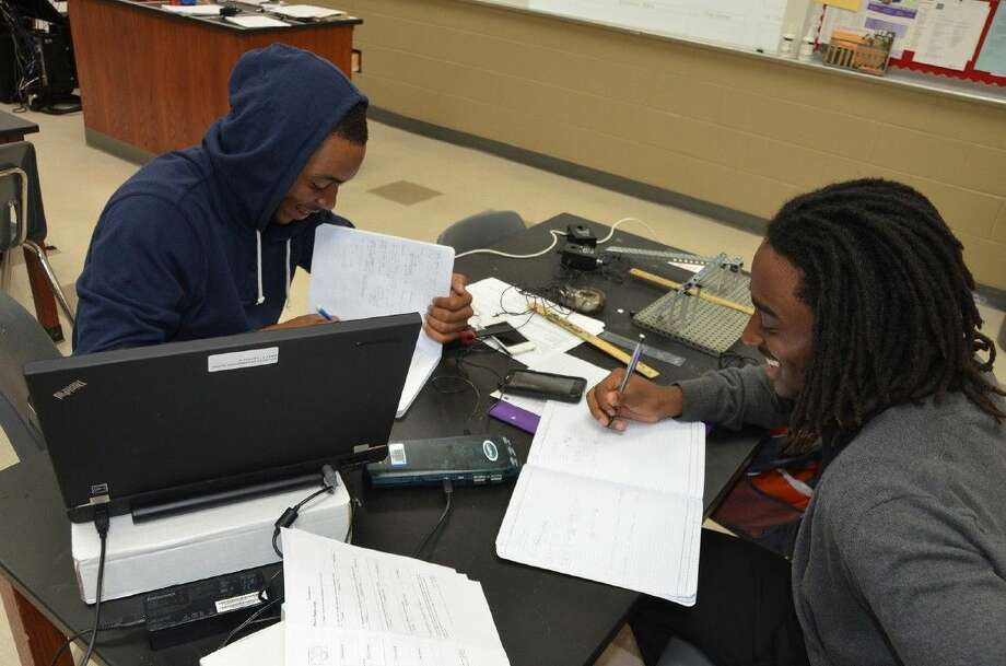 Submitted PhotoCypress Lakes juniors Kody Weatherspoon and Isaiah Sherwood work together in their PLTW engineering class. The Cypress Lakes PLTW program earned national certification this week. Photo: Submitted Photo