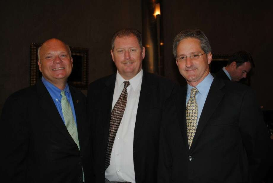 Moody National Bank President Vic Pierson, from left, Galveston County Commissioner Ken Clark and Pasadena City Councilman Darrell Morrison were among the many attending the BayTran luncheon at Cullen's.
