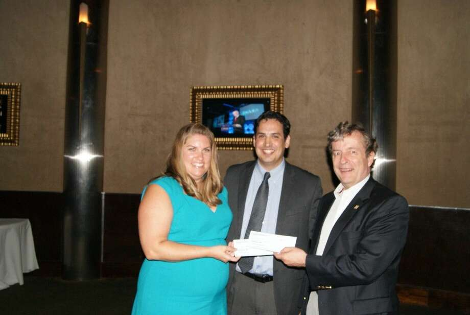Stacey Welch - Education Specialist from Texas Aerospace Scholars program (left), RNASA Foundation President Rodolfo González (center) and RNASA Foundation Treasurer Geoff Atwater (right) presenting a check to Stacey Welch on behalf of the NASA Texas Aerospace Scholars Program. (Photo by Pat Patton, 8-21-2014)
