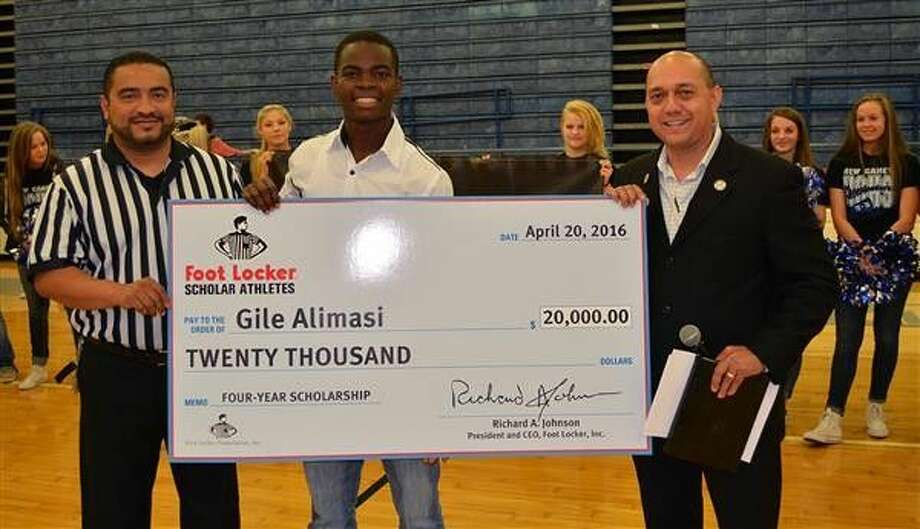New Caney High School student Gile Alimasi, center, was surprised to learn that he received a $20,000 scholarship from Foot Locker on April 20. The check was presented to Alimasi by Foot Locker Store Manager Renzo Chavarria, left, and Foot Locker District Manager Jorge Gutierrez, right.