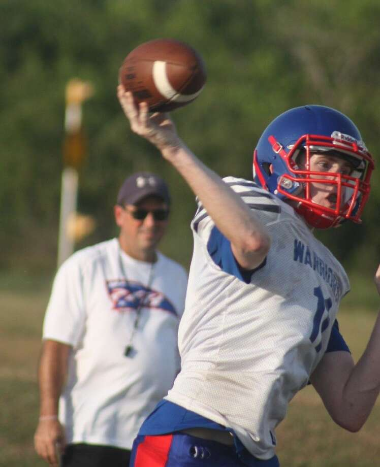 FBCA quarterback Joel Teed eyes an open receiver during a Monday night practice. Since opening practice Aug. 3, the Warriors will get their first test against an opponent when they scrimmage Ft. Bend Christian Academy Friday night at 6. Photo: Robert Avery