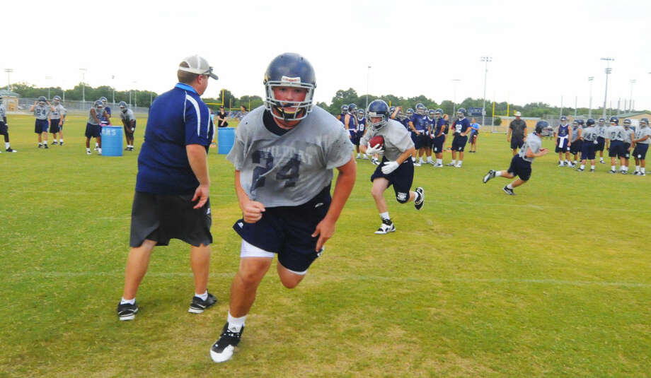 Tomball Memorial looks to transfer their achievements in the offseason into their 2015 campaign with some preseason drills. Photo: Staff Photo By Tony Gaines