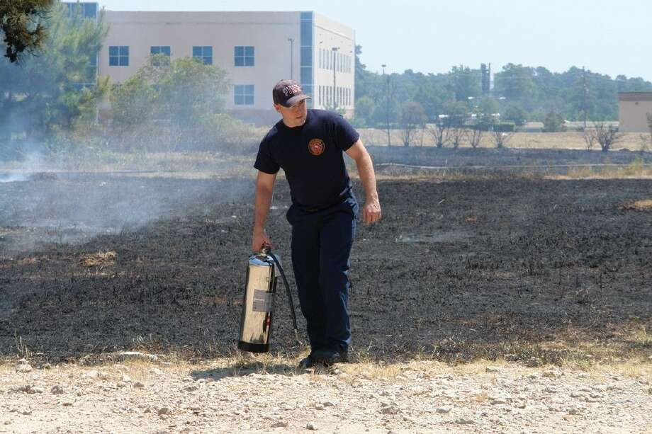 The Conroe Fire Department responded to an acre-sized grass fire near the Grand Theater off League Line Road in Conroe Tuesday. Witnesses believe an electrical wire sparked the blaze, which spread quickly throughout the acreage.
