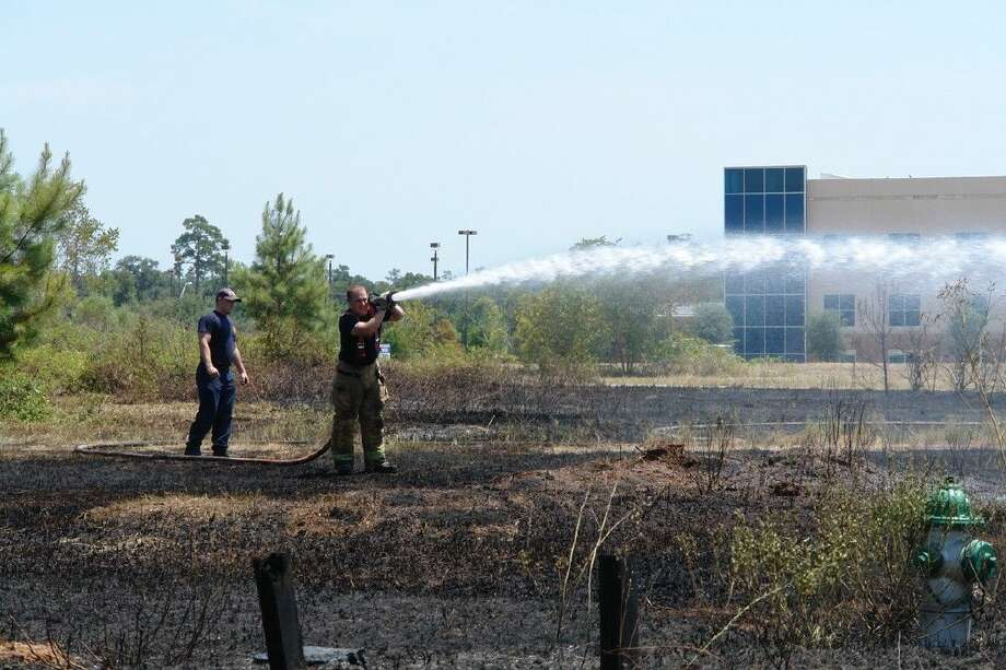 The Conroe Fire Department responded to an acre-sized grass fire near the Grand Theater off League Line Road Tuesday.