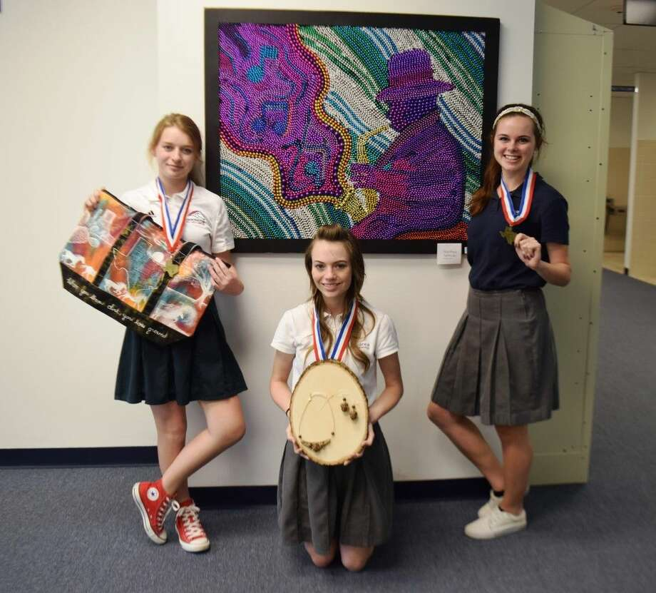 Pictured are Hannah Wooley - 1st in state Fabric Design; Charlotte Bell - 2nd in state Jewelry Design; Elizabeth Allcorn - 1st in state Mixed Media.