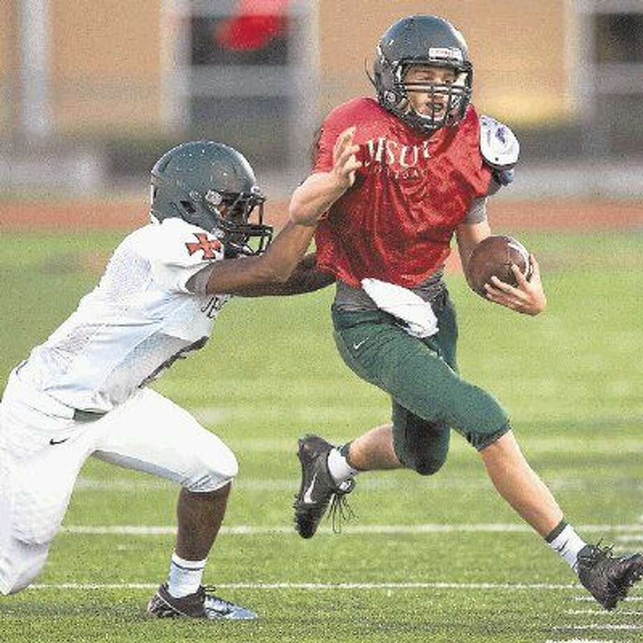 Strake Jesuit, seen here in a recent spring football game, will be one of the several teams around the city that hold their first scrimmage of the 2015 season Friday. All the local private schools along with Strake Jesuit and Lamar are in their second week of practice and will be working out with somebody this weekend. Strake Jesuit will go to Pasadena ISD Stadium Friday night for a 7 p.m. scrimmage against Dobie. Photo: Kevin B Long