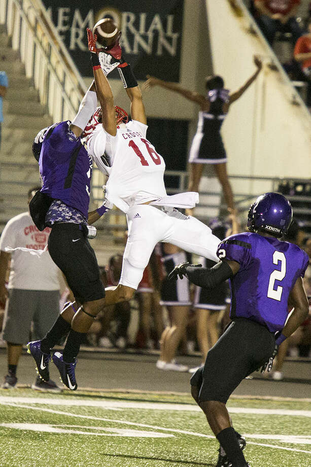Cougars wide receiver Emmanuel Netherly (16) leaps while attempting to catch a pass during Crosby's 17-10 victory over Humble on Sept. 18, 2014, at Turner Stadium.