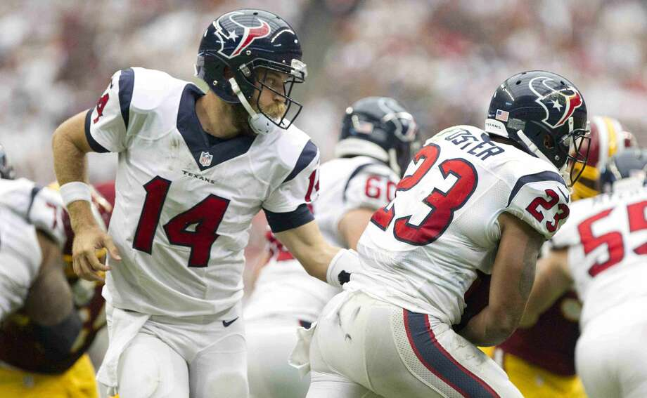 Houston Texans quarterback Ryan Fitzpatrick (14) hands the ball off to running back Arian Foster (23) in the first half of an NFL football game Sunday. Houston defeated Washington 17-6. Go to HCNpics.com to view more photos from the game. Photo: Jason Fochtman
