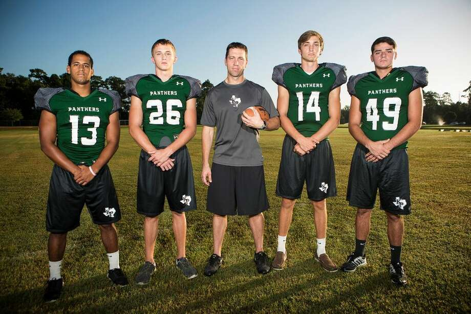 Kingwood Park prepares for the season. From left to right, Dominic Kelley, Austin Harris, Head Coach Clayton Maple, Zach Purcell and Garrett Sweeney.