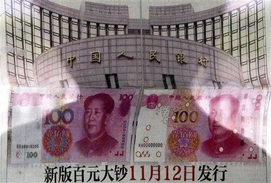 China devalued its tightly controlled currency on Tuesday following a slump in trade, triggering the yuan's biggest one-day decline in a decade. Photo: Andy Wong