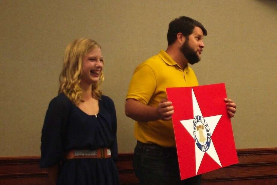 Lark Walker, left, designed the City of Liberty's new flag, adopted Tuesday evening, Aug. 11, at the Liberty City Council meeting. Dee Humber holds the design that Walker created while in his Liberty Middle School class last year. Photo: Casey Stinnett