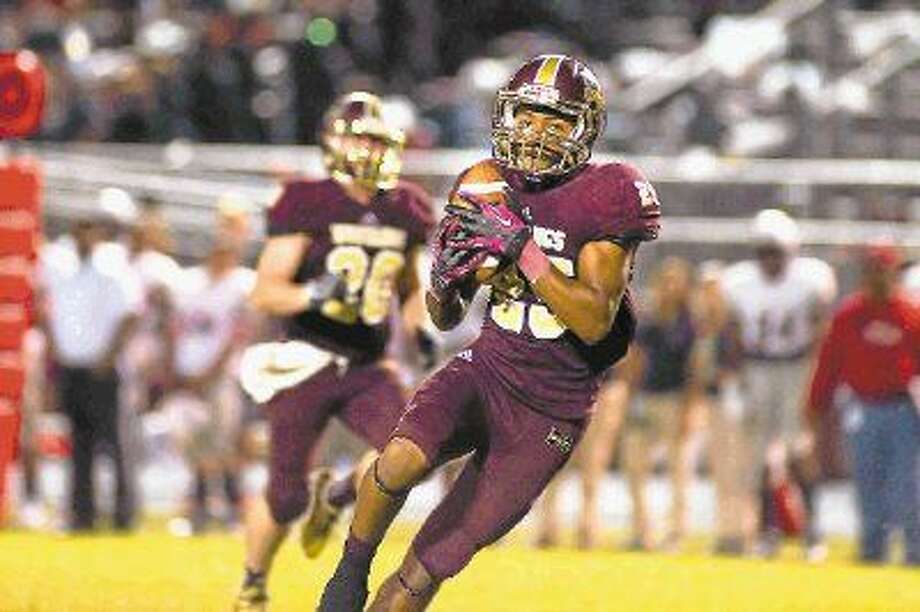 Aaron Thomas makes a catch for Magnolia West in a game earlier this season for the Mustangs.