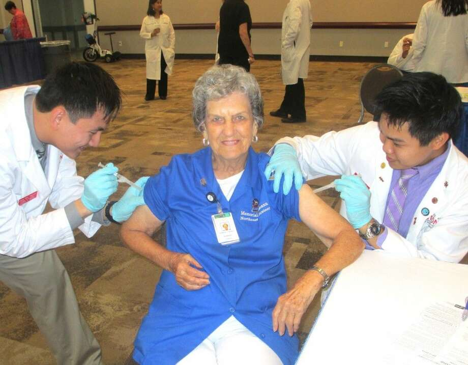 Photo by /Last year, Memorial Hermann Northeast Hospital Charter Volunteer Barbara Cordray of Kingwood received special attention from University of Houston College of Pharmacy students as she prepared to get her flu shot. The Northeast Volunteers will again help out at this year's Annual Health Fair for Seniors.