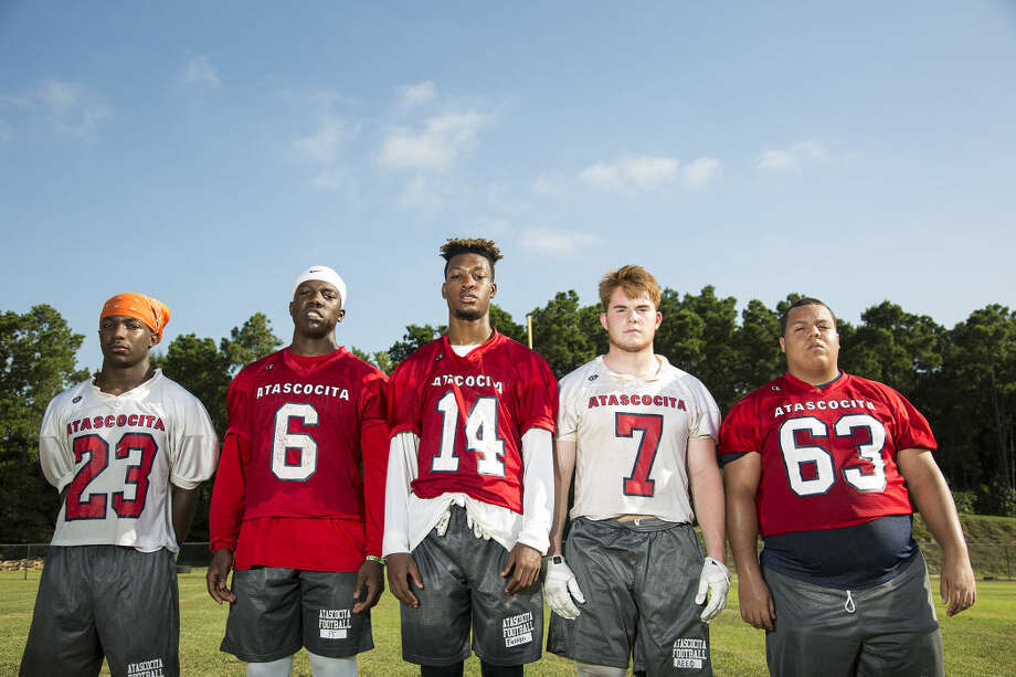 Eagles defensive back Devin Hafford (23), running back Patrick Taylor (6), wide receiver Coye Fairman (14), defensive end Jackson Reed (7) and center Logan Stump (63) pose for a portrait Aug. 10, 2015, at Atascocita High School. Photo: ANDREW BUCKLEY