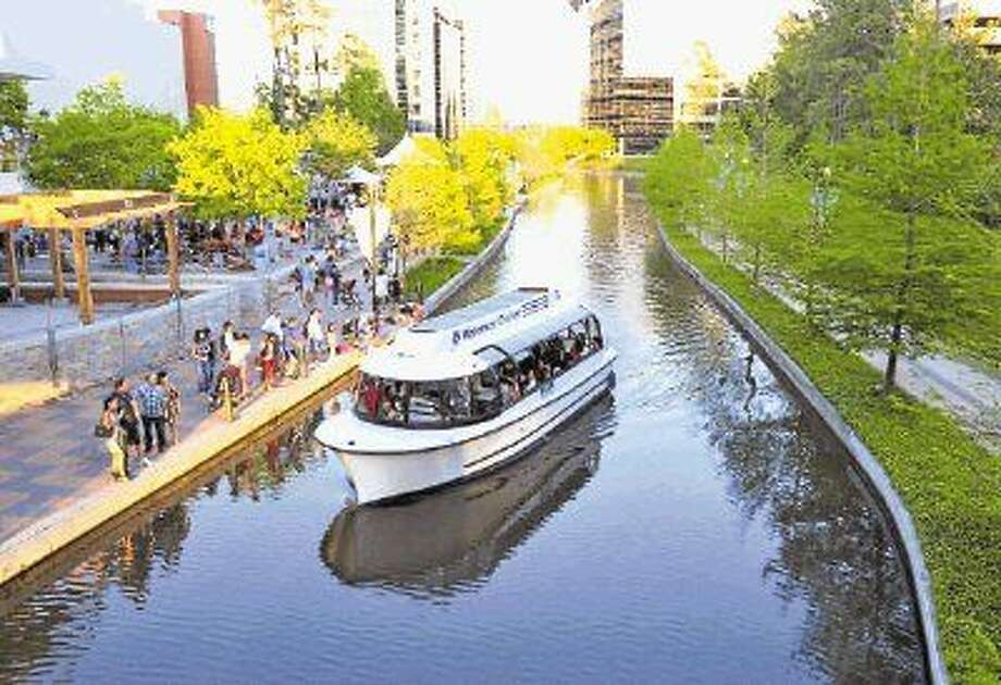 Courtesy photo by The Woodlands CVBA Waterway Cruiser drifts past Waterway Square in The Woodlands. The Woodlands CVB may consider making rides on Waterway Cruisers free. Currently, it costs $5 per adult and $2.50 per child.
