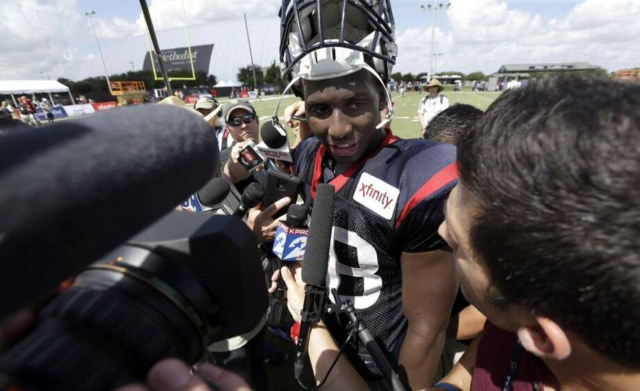 In this Aug. 5, 2015, file photo, Houston Texans running back Alfred Blue talks with the media after an NFL football training camp practice in Houston. Alfred Blue had a solid rookie season in 2014 backing up Arian Foster. Now that Foster is out indefinitely with a groin injury, Blue will be thrust into a starting role and forced to carry Houston's running game.